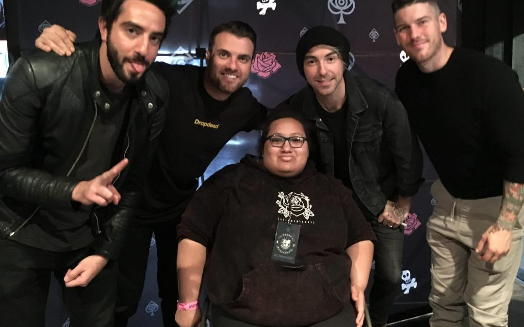 TJ Hayes, center, poses with members of the band All Time Low.